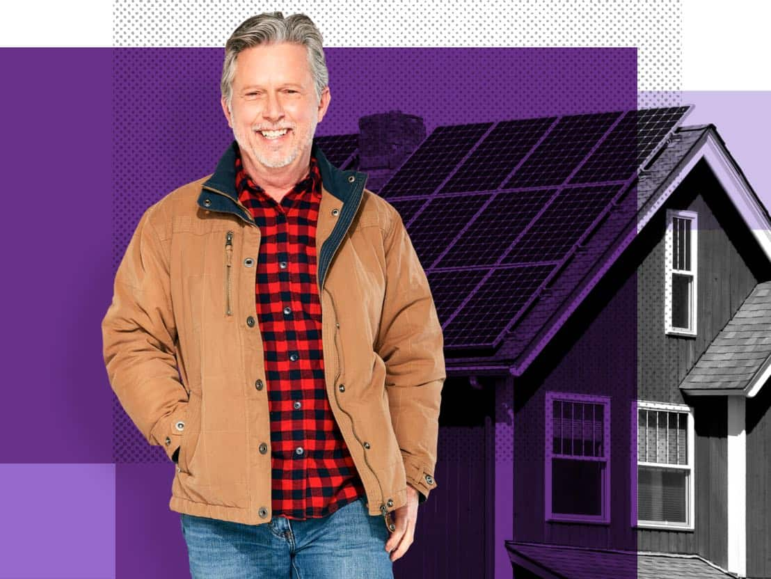 Paul, an Affinity Plus member, in front of a home with solar panels.