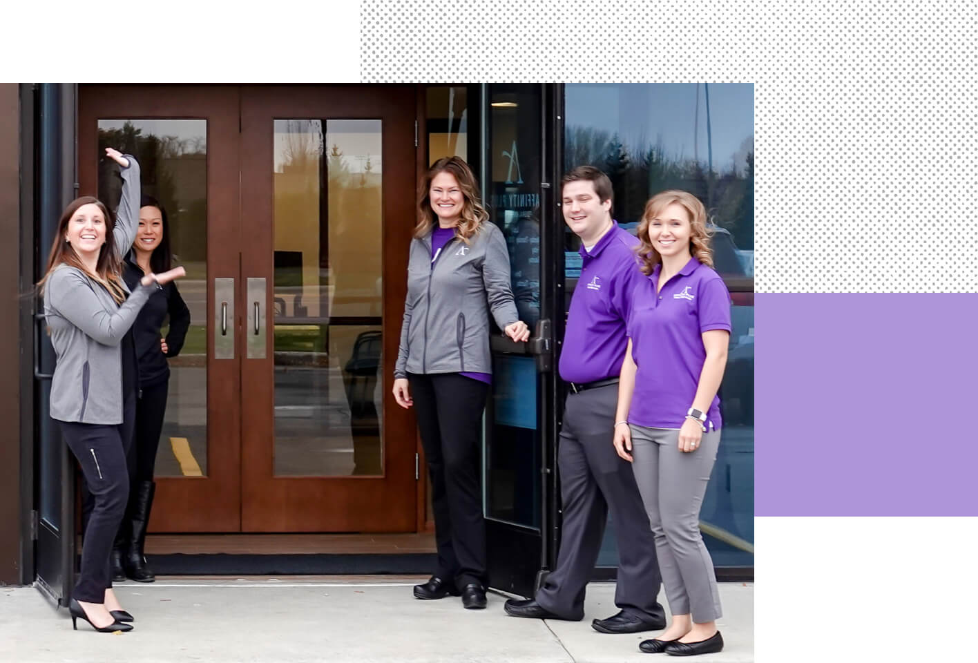 Five Affinity Plus employees stand in front of their local branch, smiling.