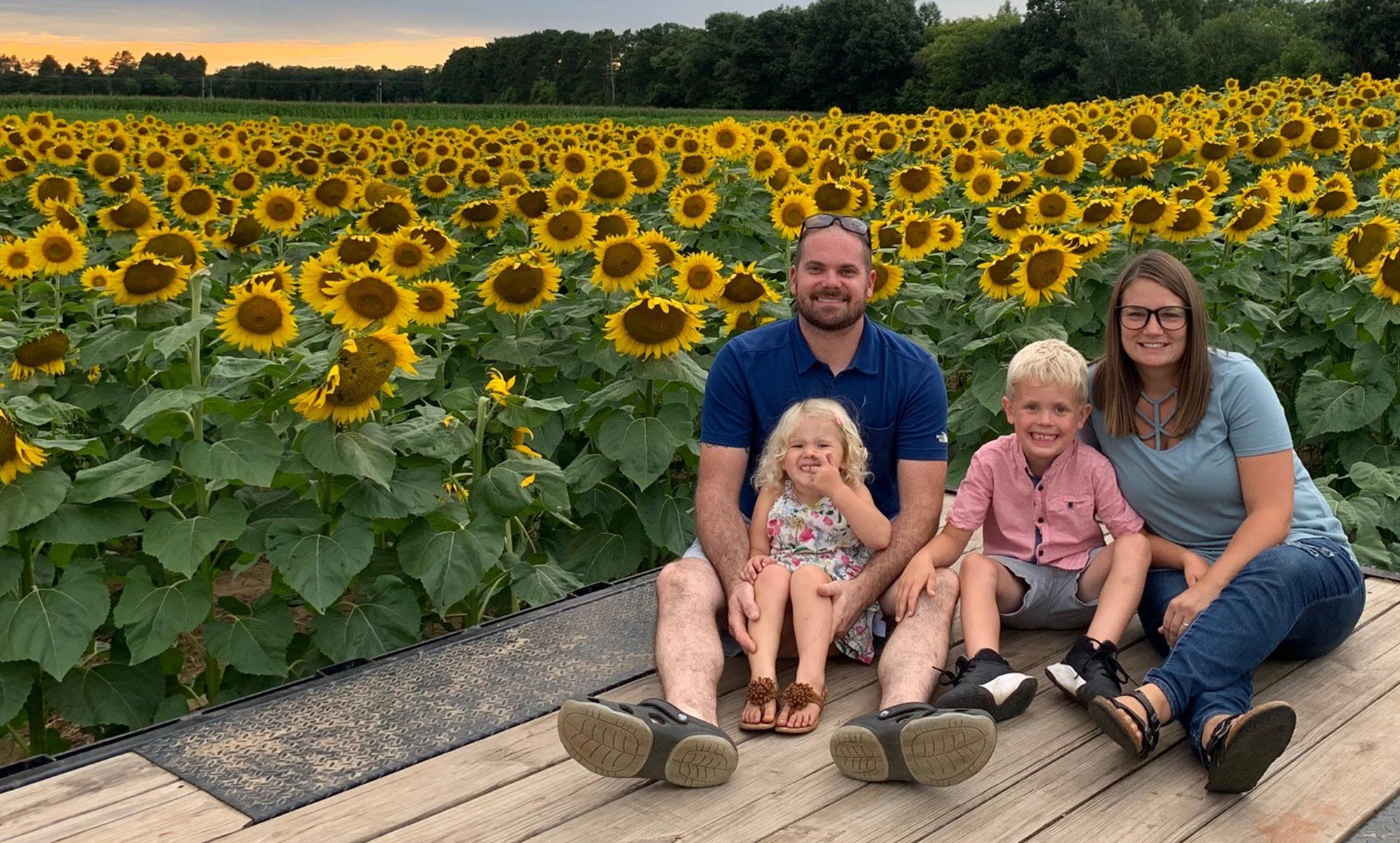 family in front of sunflowers