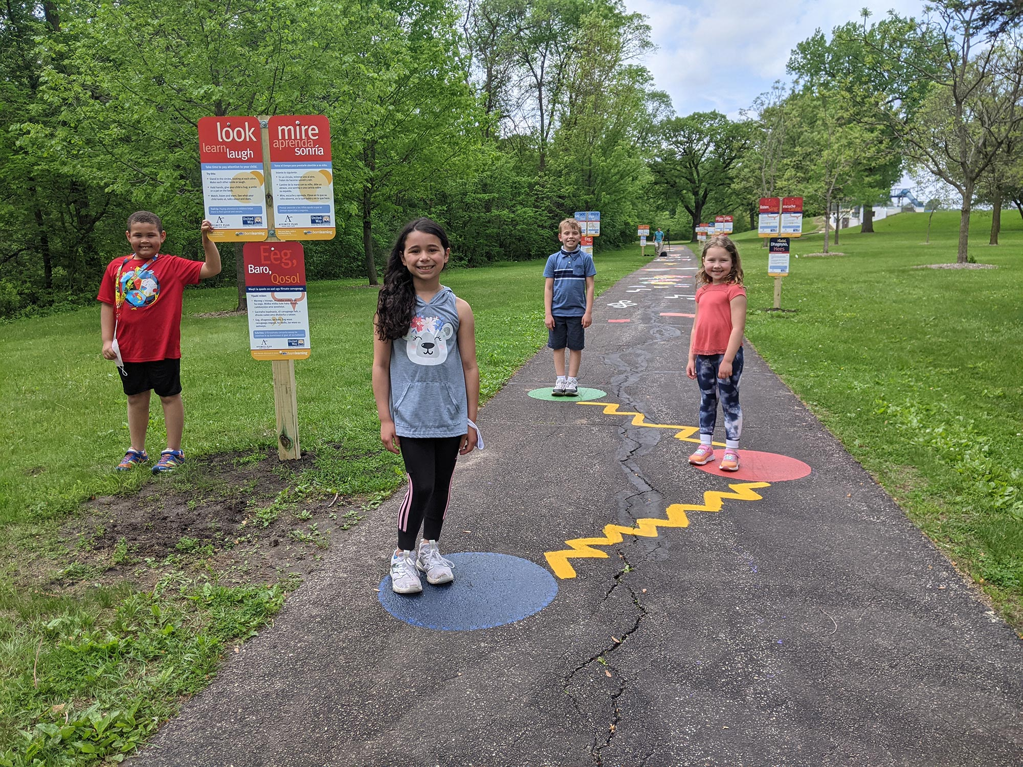 A group of children posing on a path