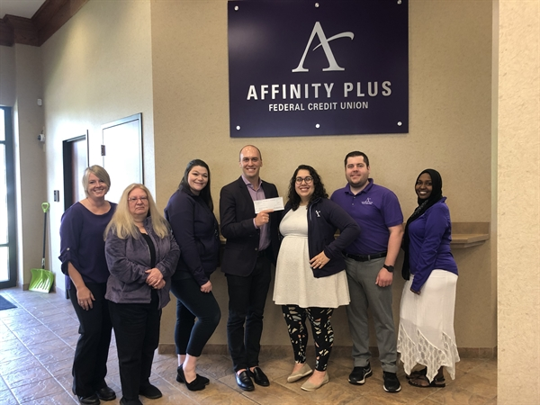 Rochester Affinity Plus employees presenting donation to Channel One