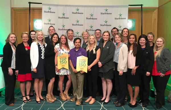 Affinity Plus employees accepting the 2019 Star Tribune Top Workplace award